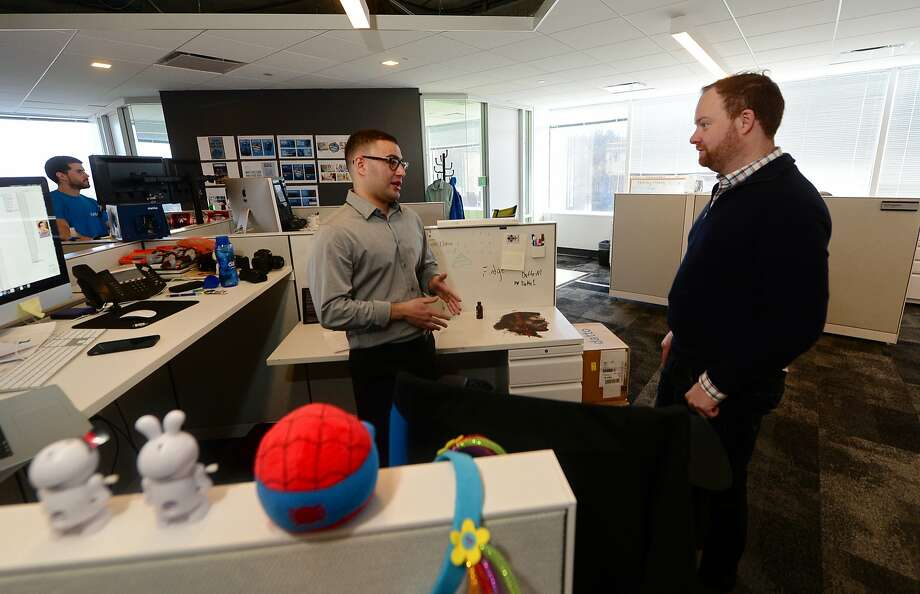 CEO/Founder of Datto, Austin McChord, chats with videographer Fuji Panjali, at their Norwalk, Connecticut office Tuesday April 19, 2016. McChord was named to Forbes 30 under 30 list. Photo: Erik Trautmann, Hearst Connecticut Media
