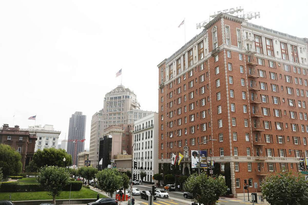 The Scarlet Huntington (right), the Intercontinental Mark Hopkins (left of center with American flag atop), the Stanford Court Hotel (directly left of Intercontinental Mark Hopkins) and Fairmont San Francisco (partially seen second from left) are seen on Monday, August 27, 2018 in San Francisco, Calif.