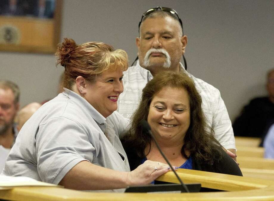Donna Baumgartner, left, gets a hug from Denise Jimenez during Montgomery County Commissioners Court at the Alan B. Sadler Commissioners Court Building on Tuesday, Aug. 28, 2018, in Conroe. The court unanimously voted to rename a portion of Texas 242 from U.S. Highway 59 to FM 1485 to The Sergeant Stacey Baumgartner Memorial Highway. Donna's husband and Patton Village Police Department Sgt. Stacey Baumgartner was killed when he collided with an SUV while chasing a suspect on Texas 242 on June 19, 2016. Photo: Jason Fochtman, Houston Chronicle / Staff Photographer / © 2018 Houston Chronicle
