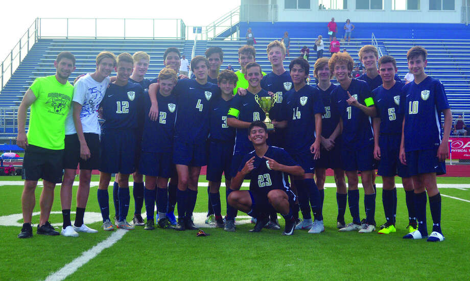 The Father McGivney boys' soccer team poses with the trophy after beating Mount Vernon on Saturday in the Puma Bracket championship game of the Metro Cup. It was the tournament title for the Griffins in four years as a varsity squad. Photo: Scott Marion