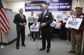 GOP candidates, John Cox (left) for governor and Steve Bailey (middle) for attorney general  have a press conference at the San Mateo Republican Party Headquarters on Thursday, May 24, 2018 in Burlingame, Calif.
