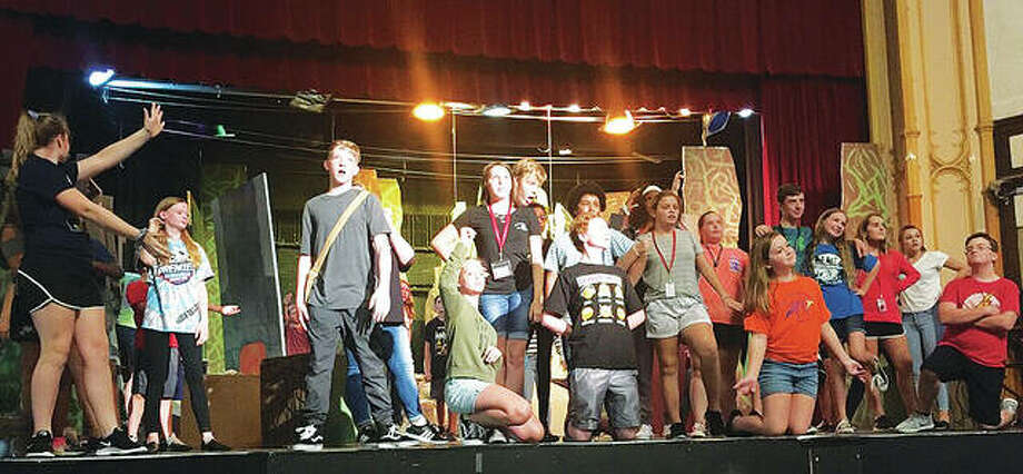 """""""Into the Woods Jr."""" cast features Nadja Kapetanovich (Cinderella), Devin Sadler (Jack), James Harbaugh (Baker) and Corrine Jones (Baker's wife), as well as many other Alton Middle School students. Photo: For The Telegraph"""