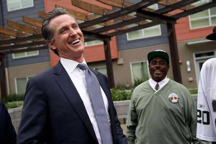 SAN FRANCISCO, CA - AUGUST 22:  California Lt. Gov. and California gubernatorial candidate Gavin Newsom (L) laughs with a resident as he visits the Alice Griffith Apartments on August 22, 2018 in San Francisco, California. Lt. Gov. Gavin Newsom and San Francisco mayor London Breed toured a low-income housing complex. Newsom leads Republican gubernatorial candidate John Cox by an average of 23 percentage points in recent polls.  (Photo by Justin Sullivan/Getty Images)