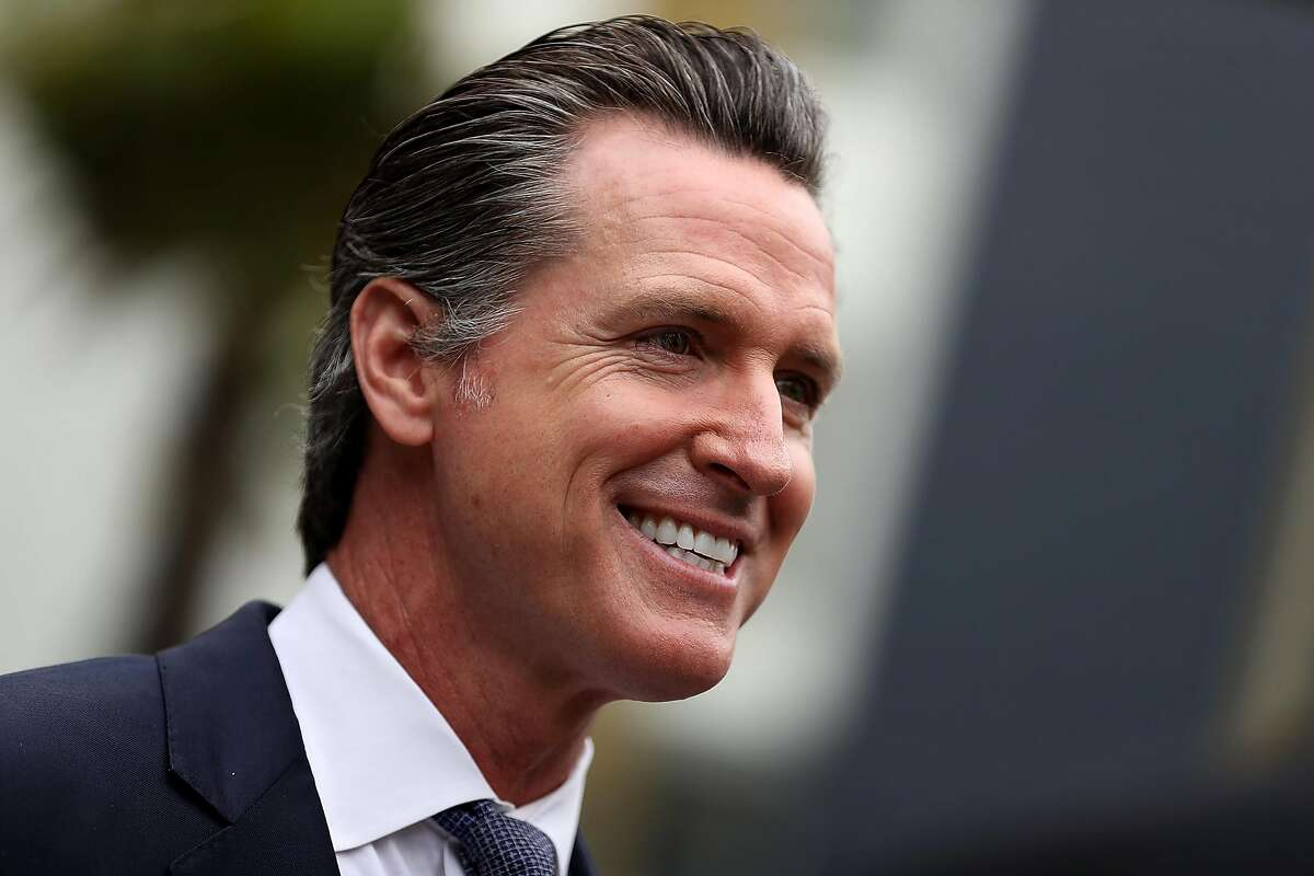 California Lt. Gov. and California gubernatorial candidate Gavin Newsom looks on as he visits the Alice Griffith Apartments on August 22, 2018 in San Francisco, California.