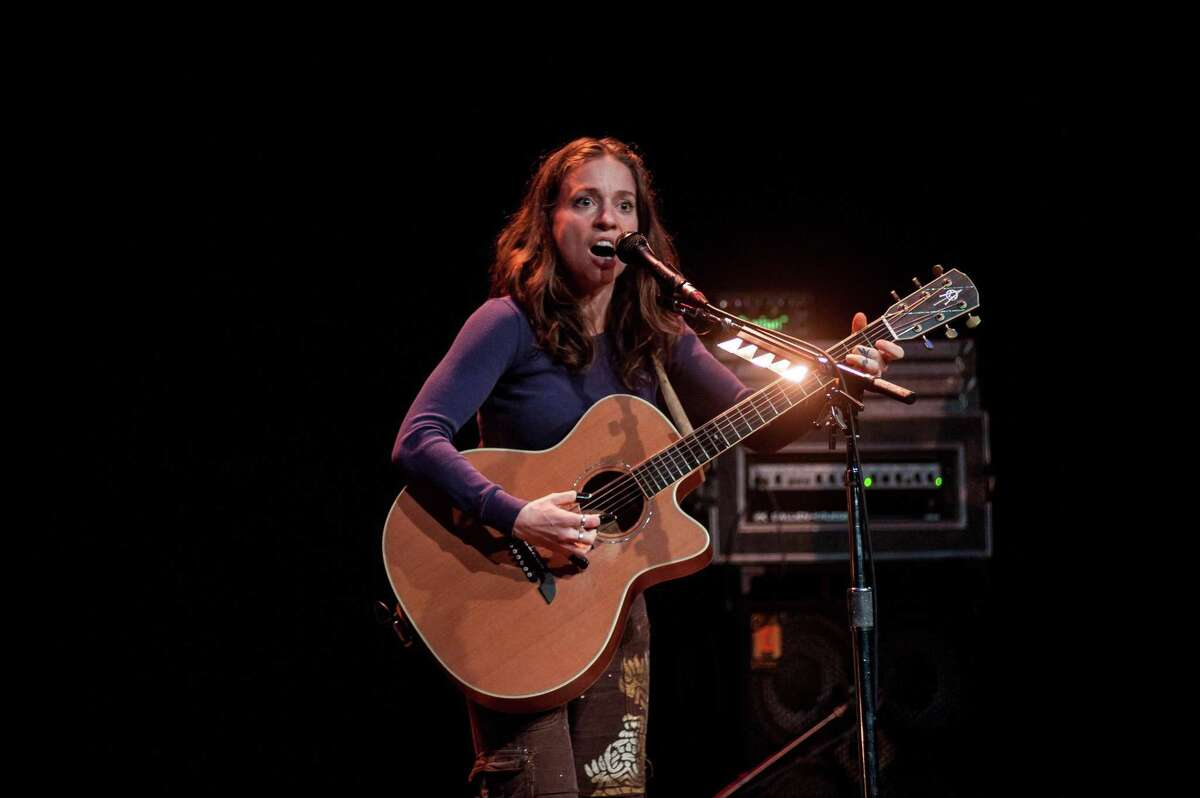 EDINBURGH, UNITED KINGDOM - SEPTEMBER 19: Ani DiFranco performs on stage at Queens Hall on September 19, 2014 in Edinburgh, United Kingdom. (Photo by Roberto Ricciuti/Redferns via Getty Images)