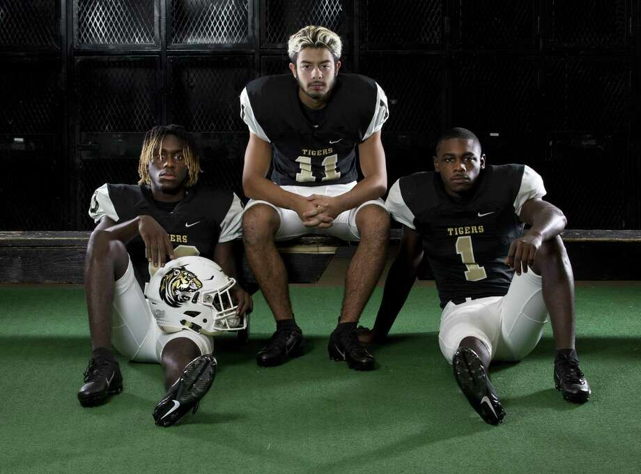 Conroe football seniors (from left) Jay Smith, Michael Gutierrez and Coco Sneed. Photo: Jason Fochtman, Staff Photographer / Houston Chronicle / © 2018 Houston Chronicle