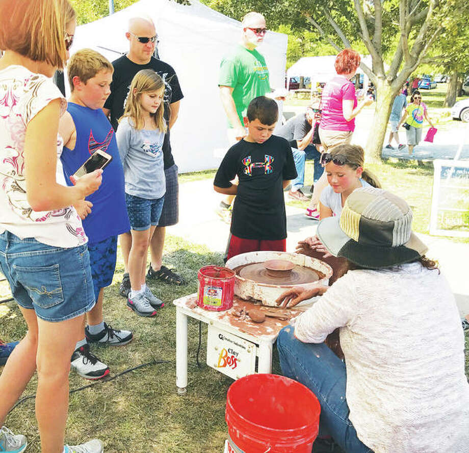 Art demonstrations, as shown from last year, will be presented throughout Grafton's 12th annual Art in the Park weekend on candle making, basket creation and pottery. Fun activities will be available for children throughout the weekend, provided by the Grafton United Methodist Church. Photo: For The Telegraph