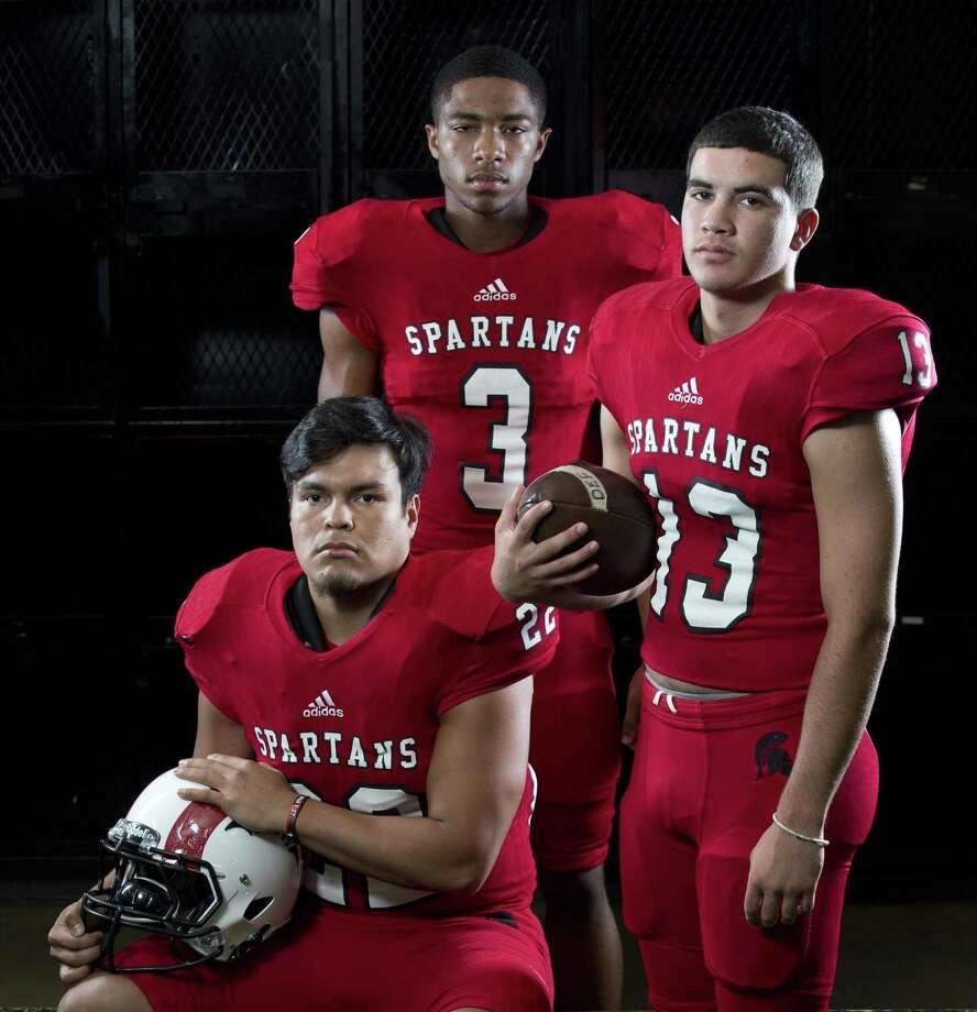Porter senior football players Joey Corona (22), Corey Perkins (3) and Tayler Baker (13). Photo: Jason Fochtman, Staff Photographer / Houston Chronicle / © 2018 Houston Chronicle