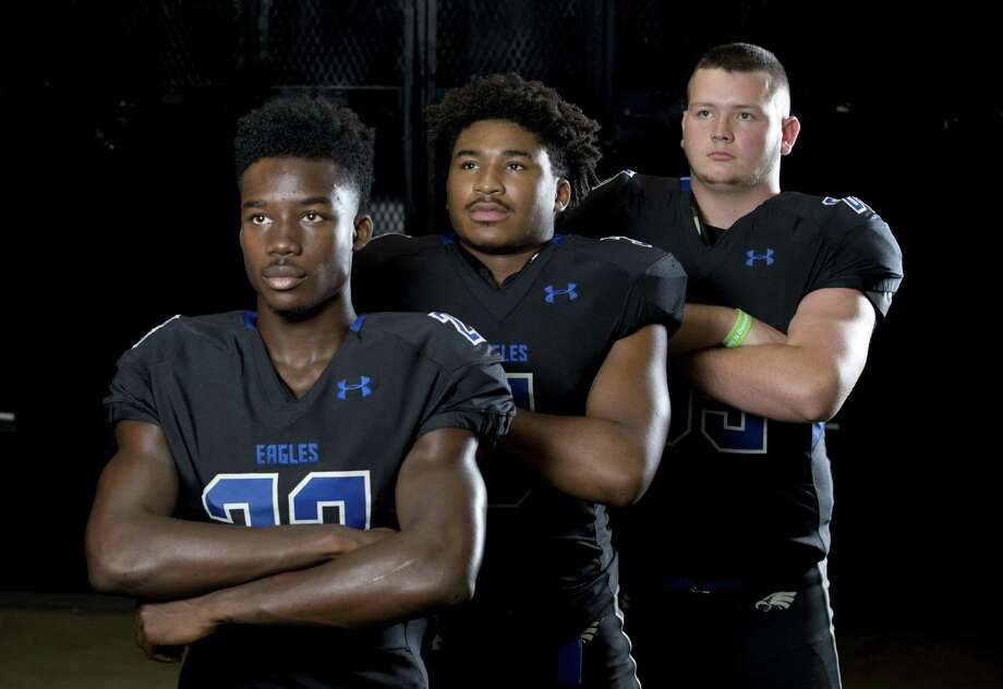 New Caney seniors (from left) Jaylen Neal, Shorn Young and Brayden Mills. Photo: Jason Fochtman, Staff Photographer / Houston Chronicle / © 2018 Houston Chronicle