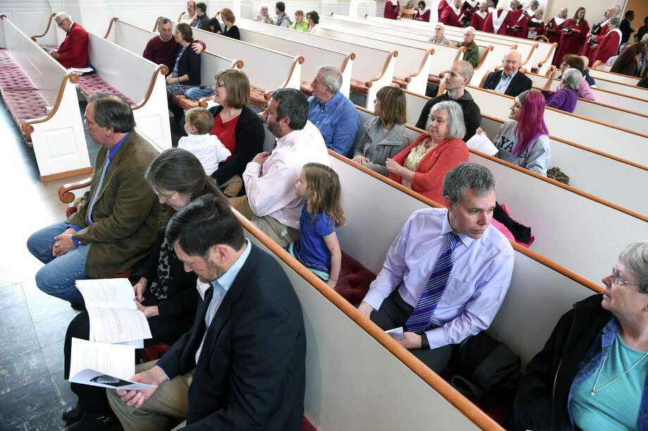 Parishioners wait for services to begin at the Church of the Redeemer in New Haven on April 30, 2016. Photo: Arnold Gold / Hearst Connecticut Media