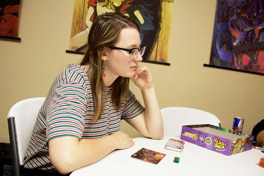 Megan Aaron plays a game during Geek Club Inc.'s weekly game night 8-20-2018. Tori Aldana/191 News Photo: Tori Aldana