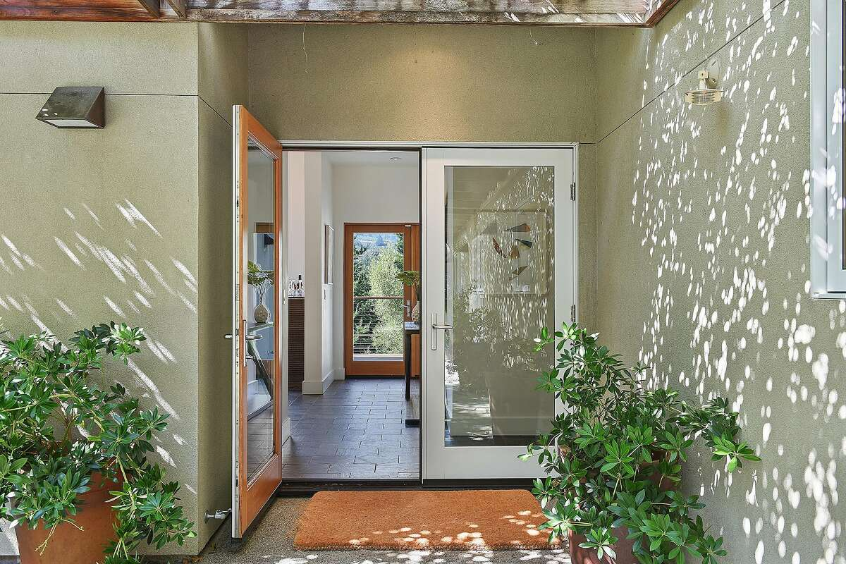 French doors in the home�s entryway look through the back of the Mill Valley home.