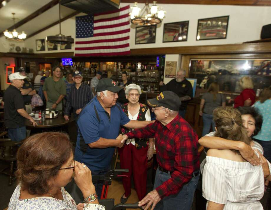 World War II veteran Willie Mendez reacts to seeing friends and family during his 93rd birthday celebration at Veterans of Foreign Wars Post 4709 on Tuesday, Aug. 28, 2018, in Conroe. Photo: Jason Fochtman, Houston Chronicle / Staff Photographer / © 2018 Houston Chronicle