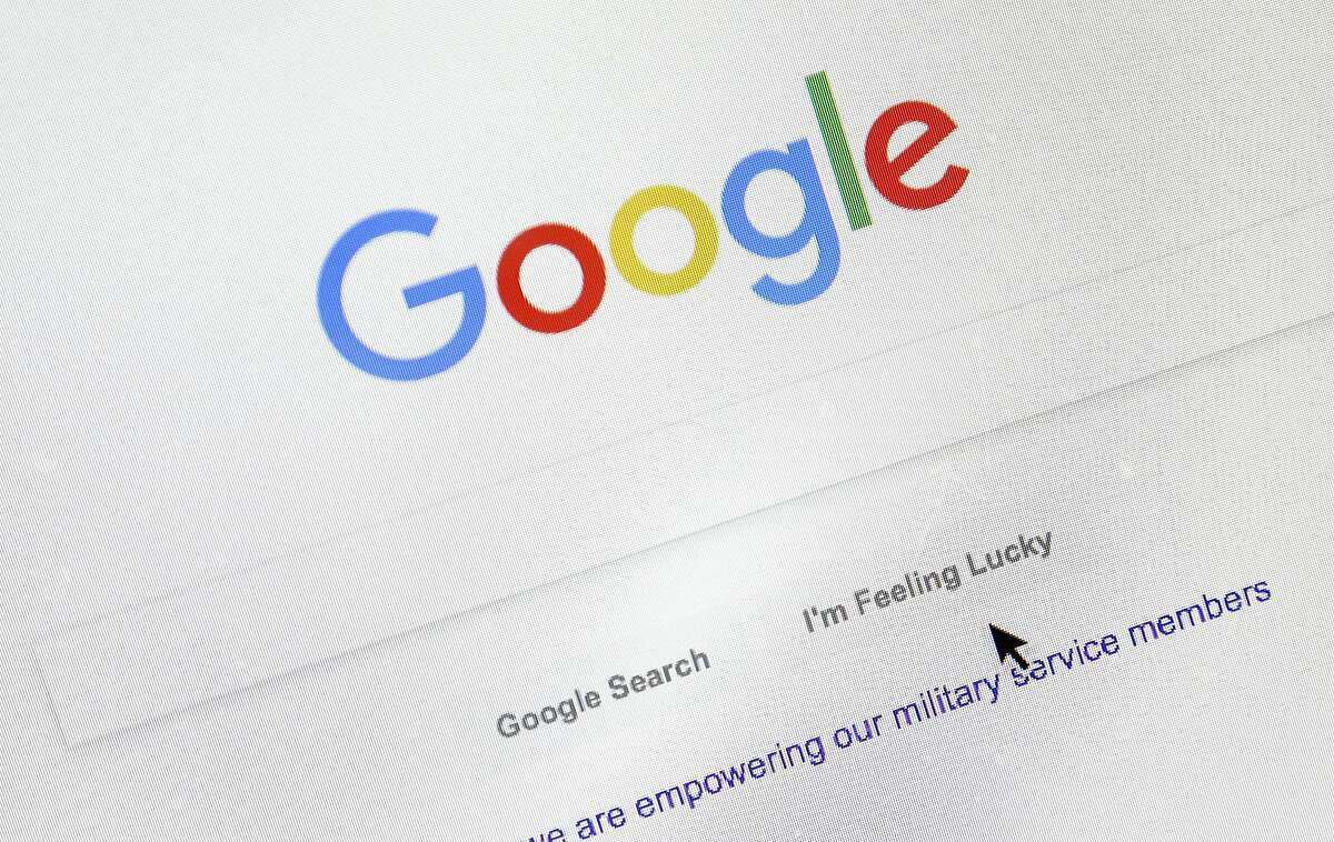 A cursor moves over Google's search engine page on Tuesday, Aug. 28, 2018, in Portland, Ore. Political leanings don�t factor into Google�s search algorithm. But the authoritativeness of page links the algorithm spits out and the perception of thousands of human raters do. (AP Photo/Don Ryan)
