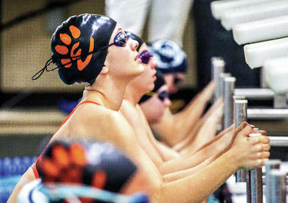 Edwardsville's Phoebe Gremaud and her teammates are aiming at state meet berths this season. Gremaud is shown at the start of a backstroke race last season. Photo: Telegraph Photo
