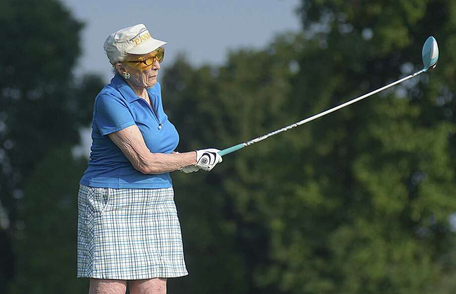 Ninety-year-old Caryl Beatus tees off on the 12th hole at the Longshore Golf Course in Westport on Tuesday morning, during the second annual Caryl Beatus Tournament, named in her honor. Beatus, a longtime resident of Westport, is one of the founding members of the Longshore Women's Golf Association, which started in 1960. Photo: John Nash/Hearst Media Connecticut
