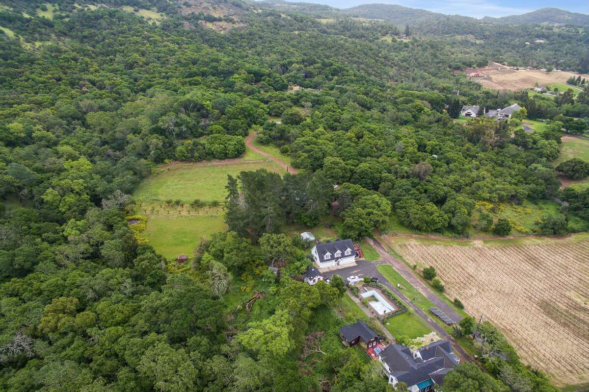 In the heart of California wine country, a 23-plus acre tract of land in Napa with several buildings, including a fixer home and a four-car garage, is listed for $6.5 million.