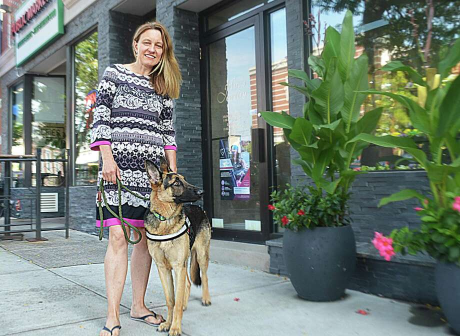 Mira Alicki, owner of Mira Jewelry on Main Street in Middletown, has established the Forever In My Heart Foundation, which rescues shelter dogs, trains them as service dogs then finds veterans they can place them with. A charity gala Sept. 16 in Hartford will raise money for the endeavor. Alicki is fostering 8-month-old Rocco, who she took in when he was two and a half months old. Photo: Cassandra Day / Hearst Media Connecticut