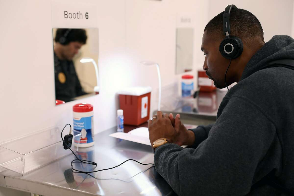 Christian Martin, executive director of Lower Polk Community Benefit District, listens to a personal testimony as he attends a tour during the Safer Inside Demonstration at GLIDE in San Francisco, Calif., on Tuesday, August 28, 2018. The demonstration was a full-scale and operational demonstration model of an overdose prevention site open to the community for outreach and education. The tours run through August 31 in the Tenderloin neighborhood.