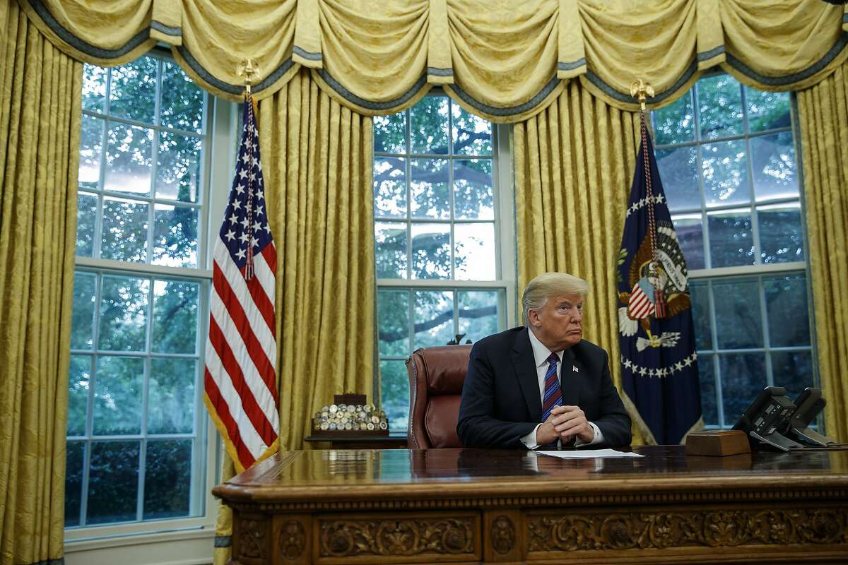 """President Donald Trump talks on the phone with Mexican President Enrique Pena Nieto, in the Oval Office of the White House, Monday, Aug. 27, 2018, in Washington. Trump is announcing a trade """"understanding"""" with Mexico that could lead to an overhaul of the North American Free Trade Agreement. Trump made the announcement Monday in the Oval Office, with Mexican President Enrique Pena Nieto joining by speakerphone. (AP Photo/Evan Vucci)"""