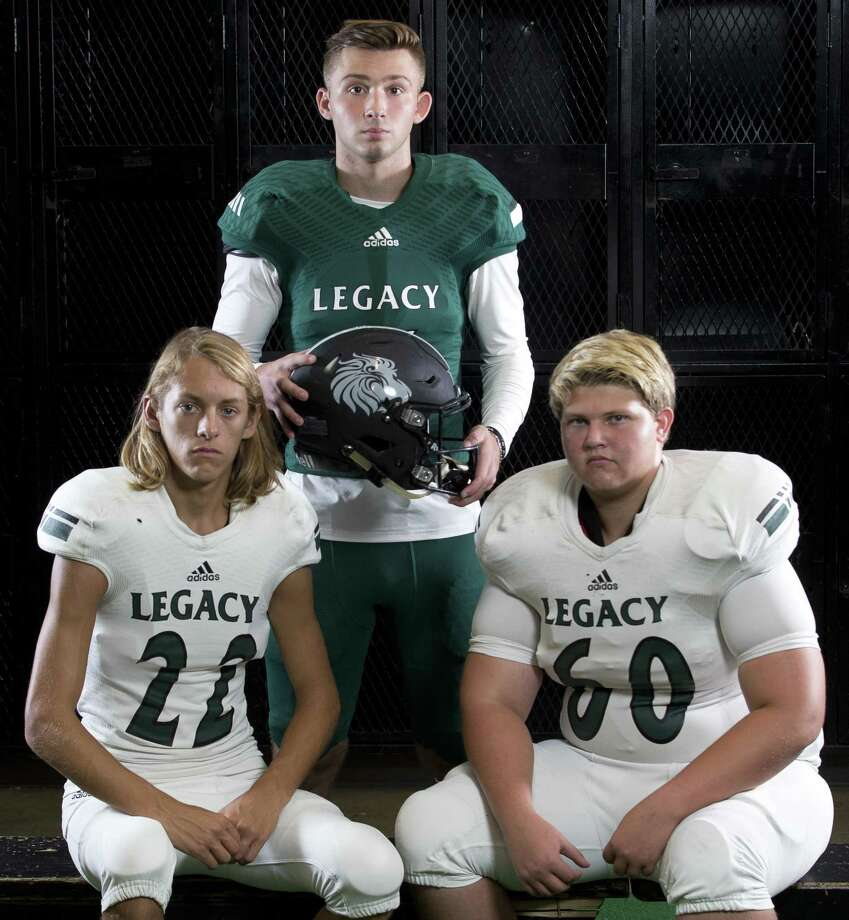 Legacy Prep's Noah Lightfoot (22), Haydan Jones (middle) and Nate McCormack (60). Photo: Jason Fochtman, Staff Photographer / Houston Chronicle / © 2018 Houston Chronicle