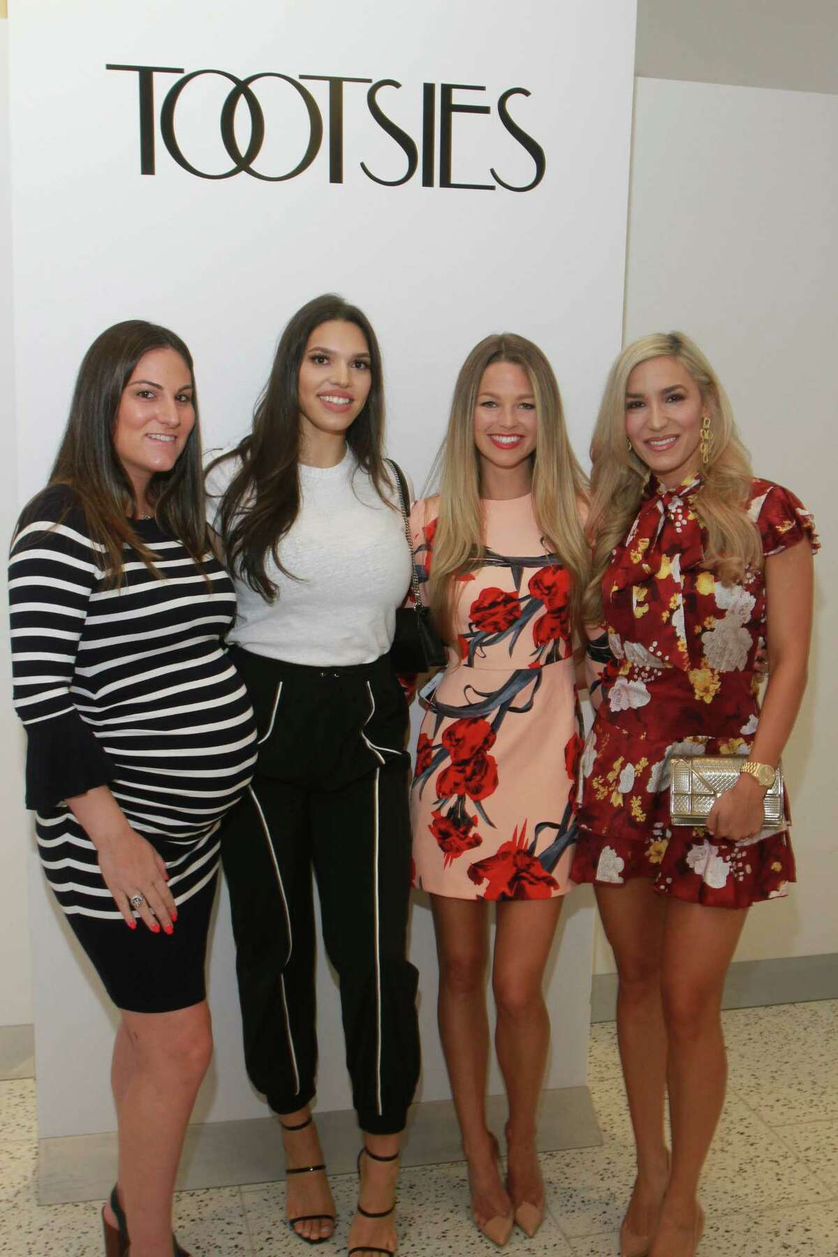 Sports reporter Allie LaForce (second from right)co-hosted a luncheon at Tootsies to help cure Huntington Diseasewith her husband and Astros pitcher Joe Smith. Fellow Astros wives Stephanie Peacock, Charlise Springerand Kara McCullers attended in support of the cause.