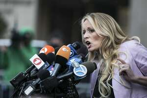 FILE-- Stephanie Clifford, the porn star better known as Stormy Daniels, speaks to reporters outside a federal courthouse after a hearing involving Michael Cohen, President Donald Trump's longtime personal lawyer, in New York, April 16, 2018. In late August, Cohen said in open court that Trump directed him to pay Clifford quite a bit of money not to tell the world that they had sex. (Jeenah Moon/The New York Times)
