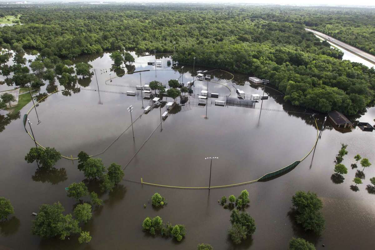 Baseball fields at Bear Creek Park are under floodwaters on Saturday, May 30, 2015, near Houston. The Colorado River, in Wharton, and the Brazos and San Jacinto rivers near Houston are the main focus of concern as floodwaters moved from the north and central Texas downstream toward the Gulf of Mexico. ( Brett Coomer / Houston Chronicle )