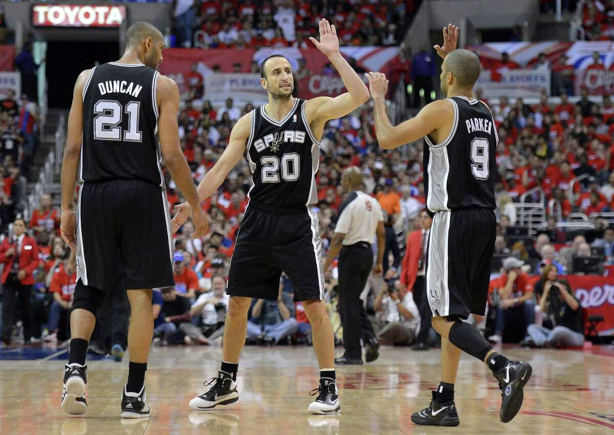 FILE - In this May 19, 2012, file photo, San Antonio Spurs guard Manu Ginobili, center, of Argentina, celebrates with center Tim Duncan, left, and guard Tony Parker of France, during the second half in Game 3 of an NBA basketball playoffs Western Conference semifinals against the Los Angeles Clippers in Los Angeles. Parker and Duncan receive a lion's share of credit for San Antonio's run of success over the past 16 years. But the Spurs know they will need a healthy Ginobili in the NBA Finals against the Miami Heat. (AP Photo/Mark J. Terrill, File)