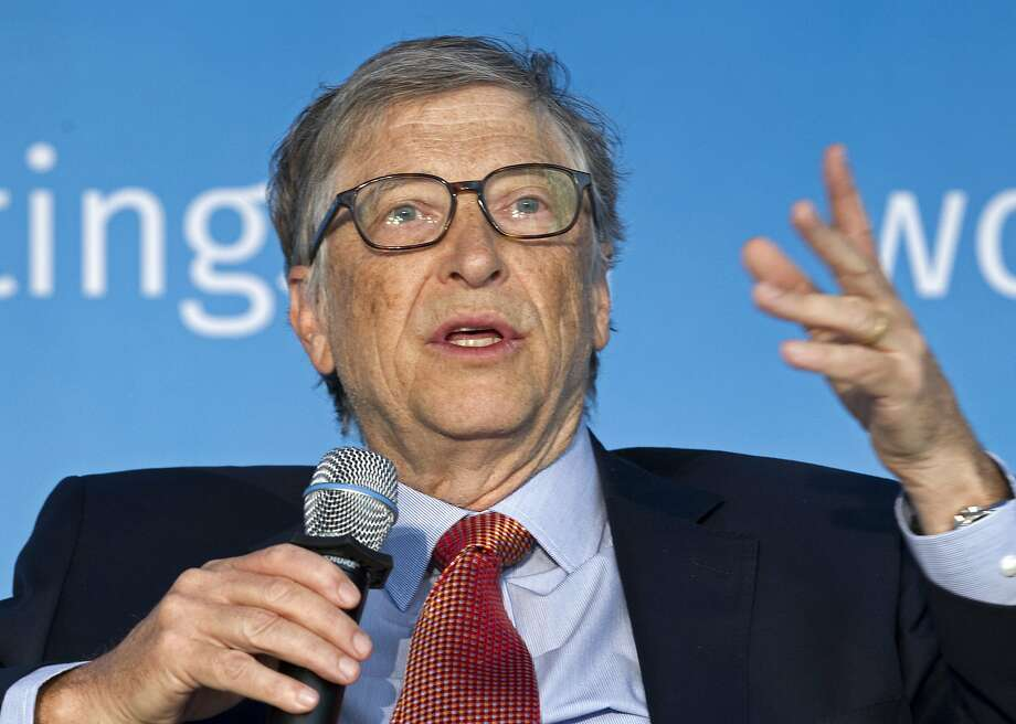 Bill Gates and his wife, Melinda, will direct grants to groups working directly with public school districts. Photo: Jose Luis Magana / Associated Press