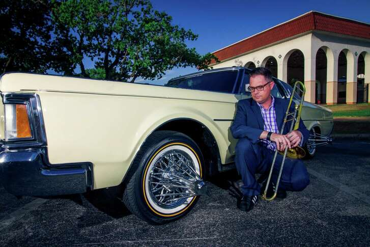 """Henry Darragh is a jazz musician from Pasadena who has created big band charts for several Houston hip-hop songs, which he's trying to record with the original artists. His first recording was """"Sittin' Sidewayz,"""" which he recorded with Paul Wall and Big Pokey. He's photographed in McGregor Park."""