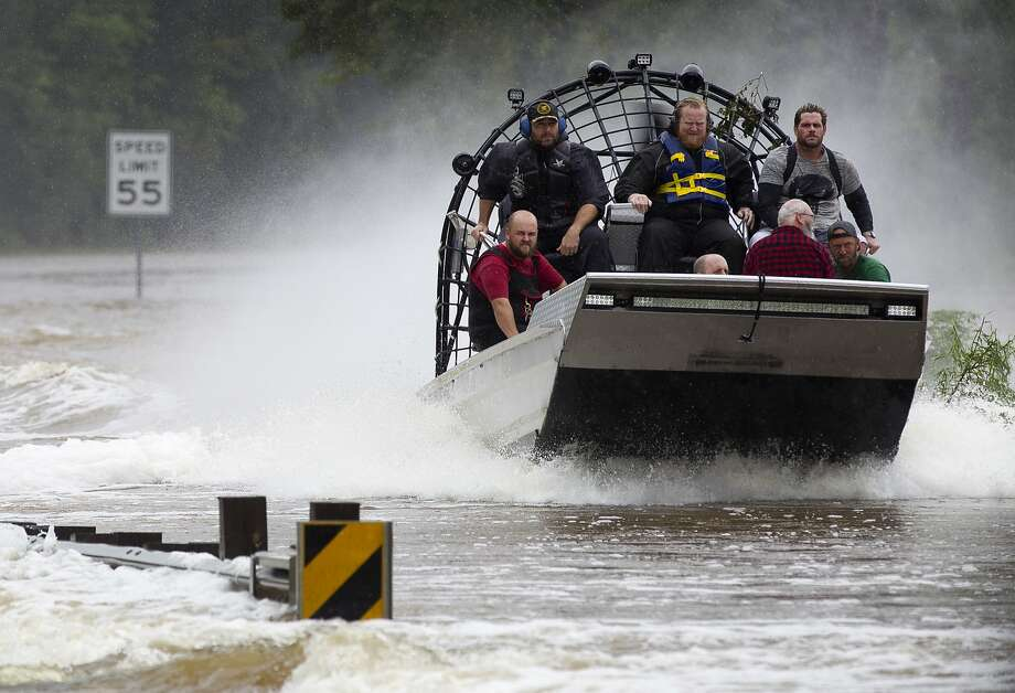 Residents are evacuated from their homes by airboat across the San Jacinto River on FM 1485, Tuesday, Aug. 29, 2017, in New Caney. Members of the Cajun Navy, a volunteer civilian group that helps those affected by disasters, helped with rescue and recovery efforts in East Montgomery County. Photo: Jason Fochtman, Staff Photographer