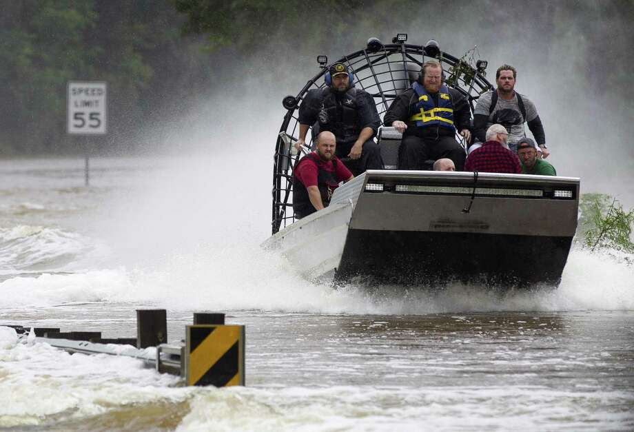 Residents are evacuated from their homes by airboat across the San Jacinto River on FM 1485, Tuesday, Aug. 29, 2017, in New Caney. Members of the Cajun Navy, a volunteer civilian group that helps those affected by disasters, helped with rescue and recovery efforts in East Montgomery County. Photo: Jason Fochtman, Houston Chronicle / Staff Photographer / © 2017 Houston Chronicle