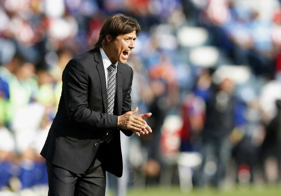 FILE - In this July 29, 2017 file photo, Chivas coach Matias Almeyda encourages his players during a Mexico League soccer match against Cruz Azul, in Mexico City. Almeyda said Thursday, August 2, 2018, that he has not received a proposal to become the head coach of the Mexico national soccer team. (AP Photo/Tomas Stargardter, File) Photo: Tomas Stargardter, Associated Press