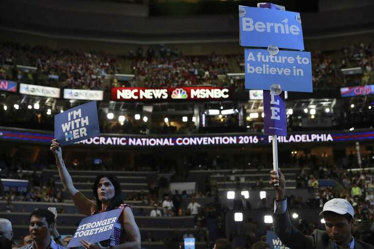 FILE — Divisions between supporters of Hillary Clinton and Bernie Sanders on display at the Democratic National Convention in Philadelphia, July 25, 2016. Democratic Party officials, desperate to present a unified front in advance of the all-important 2018 midterm elections, are working to revamp their presidential nominating process this summer and bury the final vestiges of the bitter 2016 presidential election primary. (Josh Haner/The New York Times)