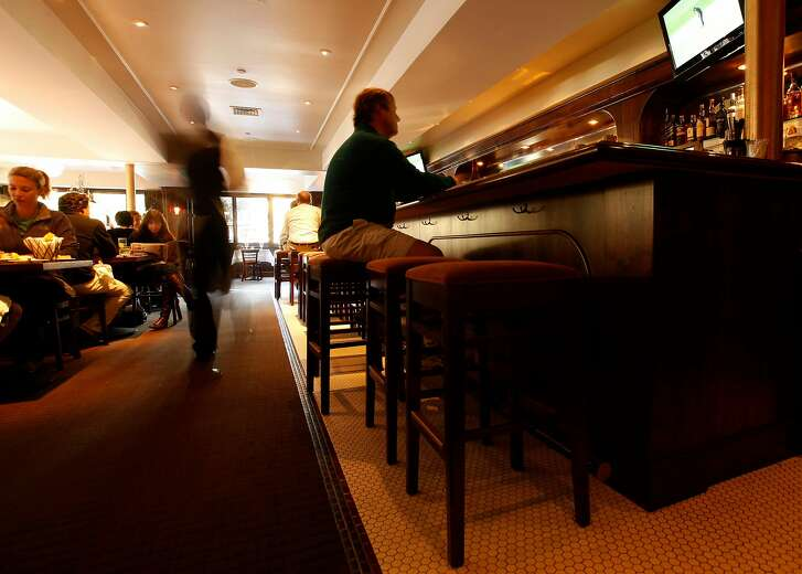 """The dark woods of the bar as well as the tables and chairs at """"Balboa Cafe"""", in Mill Valley, Calif. on Friday April 10, 2009."""