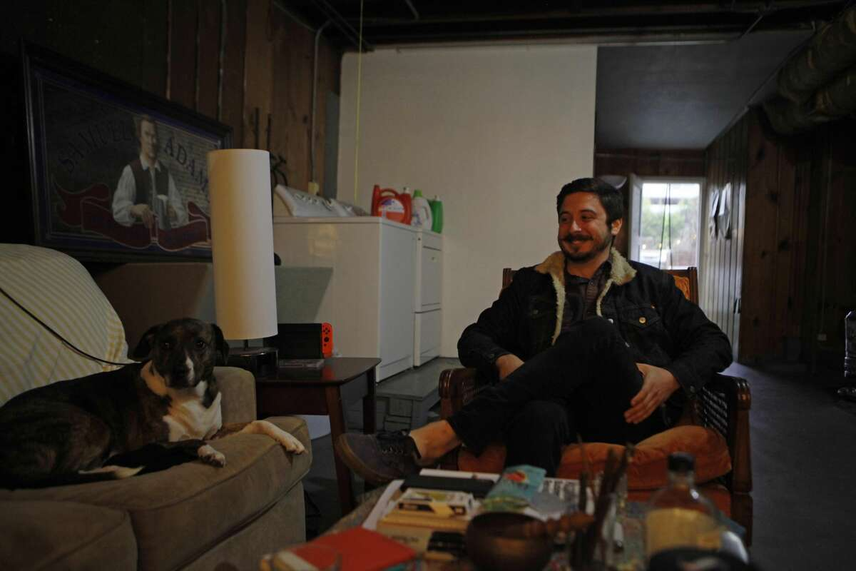 Aidan Nathanson, a 25-year-old IT project manager, lives in a refurbished garage in the Sunset District. He pays $350 a month in rent.