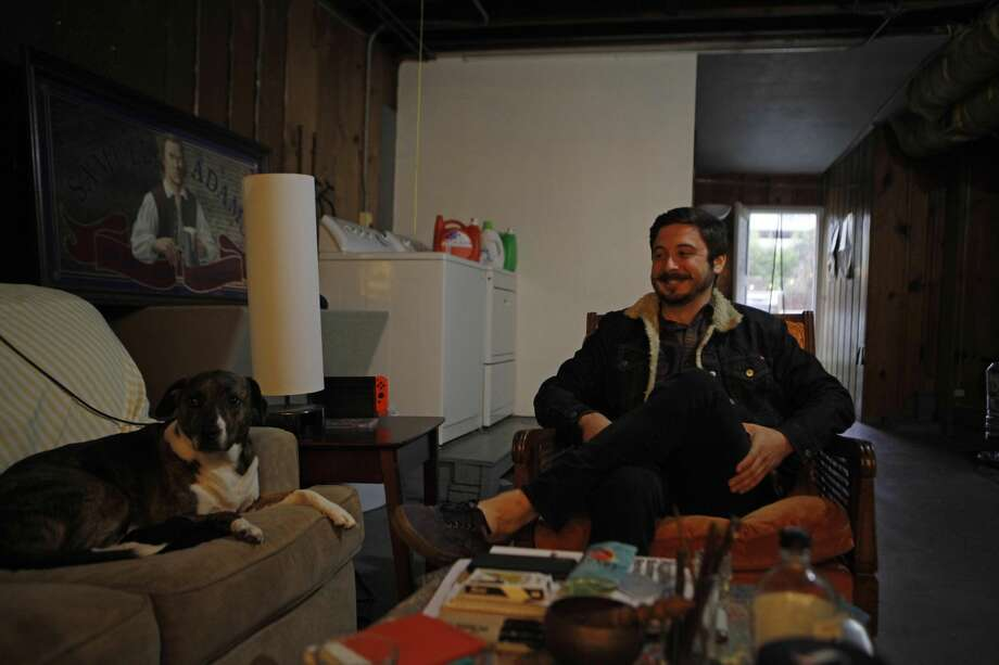 Aidan Nathanson, a 25-year-old IT project manager, lives in a refurbished garage in the Sunset District. He pays $350 a month in rent. Photo: Katie Wood/SFGATE