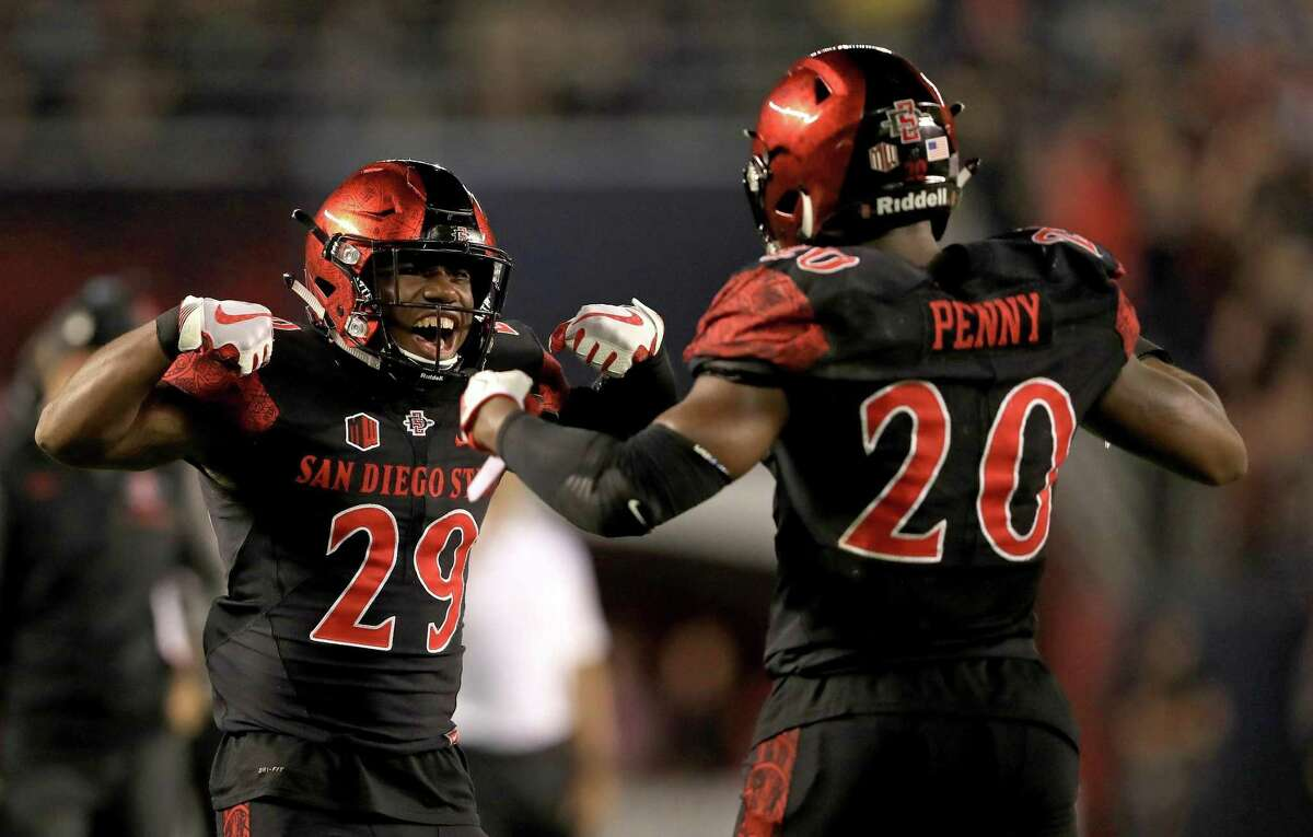 Juwan Washington (29) of the San Diego State Aztecs congratulates Rashaad Penny #20 of the San Diego State Aztecs on a touchdown during the first half of a game against the Stanford Cardinal at Qualcomm Stadium on September 16, 2017 in San Diego, California. (Photo by Sean M. Haffey/Getty Images)