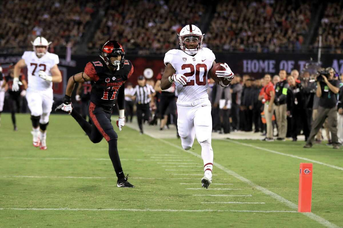 SAN DIEGO, CA - SEPTEMBER 16: Bryce Love #20 of the Stanford Cardinal runs past Ron Smith #17 of the San Diego State Aztecs for a touchdown during the first half of a game at Qualcomm Stadium on September 16, 2017 in San Diego, California. (Photo by Sean M. Haffey/Getty Images)