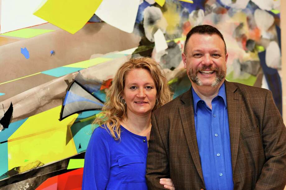 Sandy and Frank Monteiro in front of The Unfair Advantage, 2003 Kristin Baker, Acrylic on PVC. Promised gift from Jack and Pam Baker. Photo: Contributed Photo /