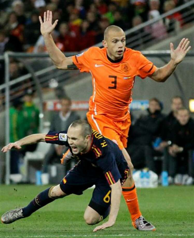 Player: John HeitingaGame: Netherlands vs. SpainOffense: Pulled back Spanish midfielder Andrés Iniesta Photo: Matt Dunham, AP / AP 2010