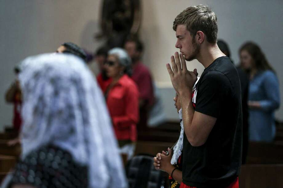 University of St. Thomas senior Peter Ellwanger prays during Mass at the Chapel of St. Basil Tuesday Aug. 28, 2018 in Houston. Photo: Michael Ciaglo, Houston Chronicle / Staff Photographer / Michael Ciaglo
