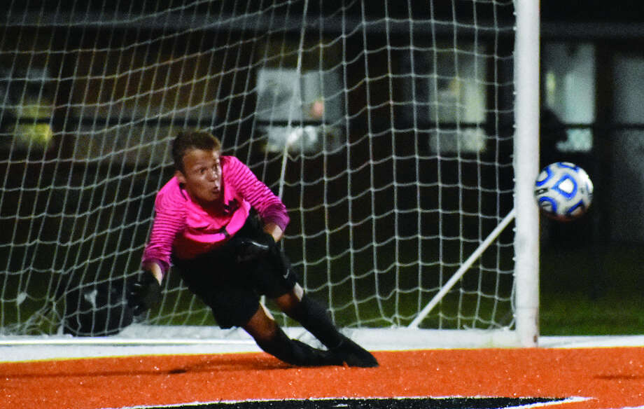 Edwardsville junior keeper Tyler Frolic makes a diving save to his right during the second half of Tuesday's Southwestern Conference game against the Belleville East Lancers inside the District 7 Sports Complex. Photo: Matthew Kamp
