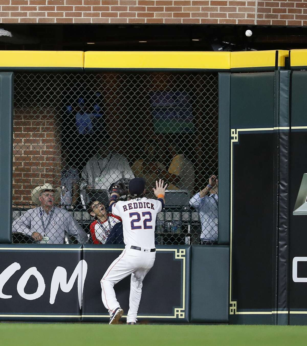 Houston Astros Josh Reddick (22) chases Oakland Athletics Nick Martini's RBI double, which was the go-ahead run during the ninth inning of an MLB baseball game at Minute Maid Park, Tuesday, August 28, 2018, in Houston.