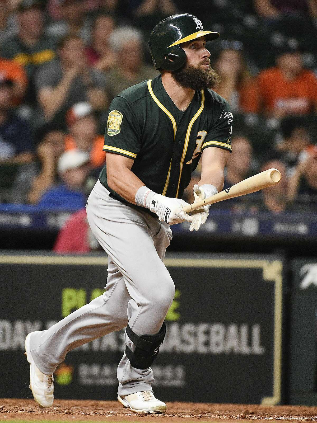 Oakland Athletics' Nick Martini watches his RBI double during the ninth inning of a baseball game against the Houston Astros, Tuesday, Aug. 28, 2018, in Houston. (AP Photo/Eric Christian Smith)