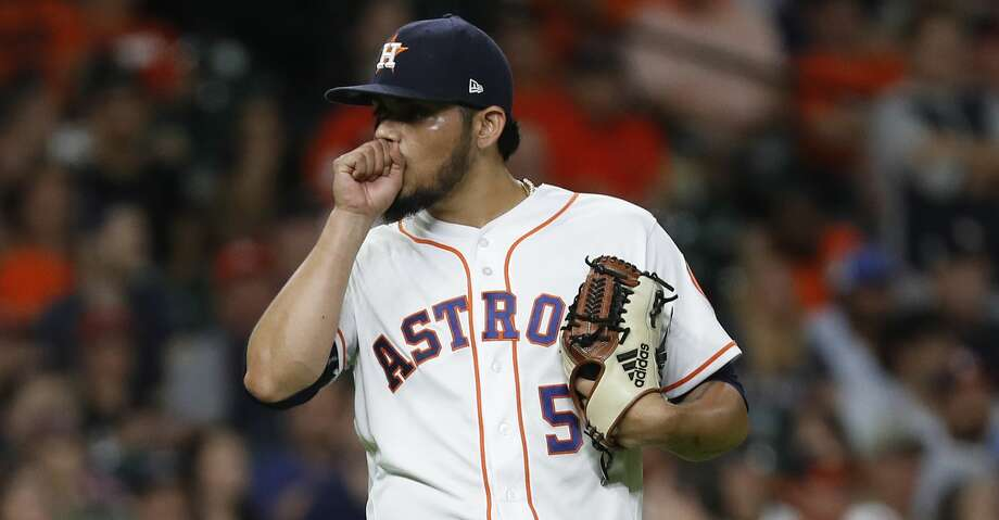 Houston Astros relief pitcher Roberto Osuna (54) reacts after Oakland Athletics Nick Martini's RBI double, the go-ahead run during the ninth inning of an MLB baseball game at Minute Maid Park, Tuesday, August 28, 2018, in Houston. Photo: Karen Warren/Houston Chronicle