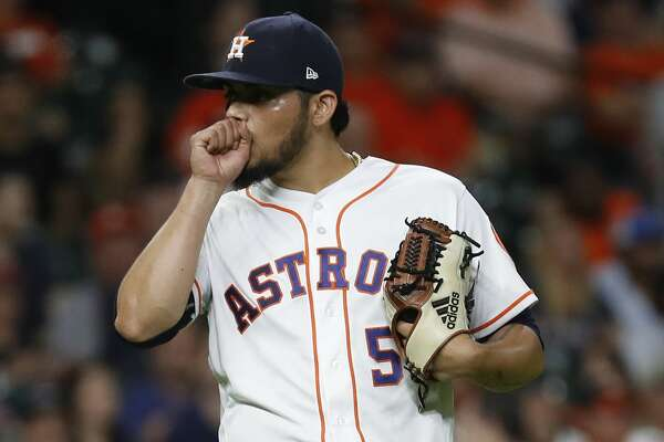 Houston Astros relief pitcher Roberto Osuna (54) reacts after Oakland Athletics Nick Martini's RBI double, the go-ahead run during the ninth inning of an MLB baseball game at Minute Maid Park, Tuesday, August 28, 2018, in Houston.