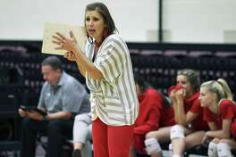 New Braunfels Canyon head coach Heather Sanders gives directions on the floor as Churchill hosts Canyon in volleyball at Littleton Gym on August 28, 2018.