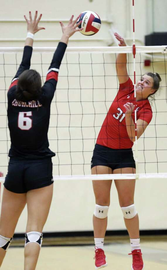 Canyon's Kylie Trefflich smacks the ball into Churchill blocker Julia Aleman as Churchill hosts Canyon in volleyball at Littleton Gym on August 28, 2018. Photo: Tom Reel, Staff / Staff Photographer / 2017 SAN ANTONIO EXPRESS-NEWS